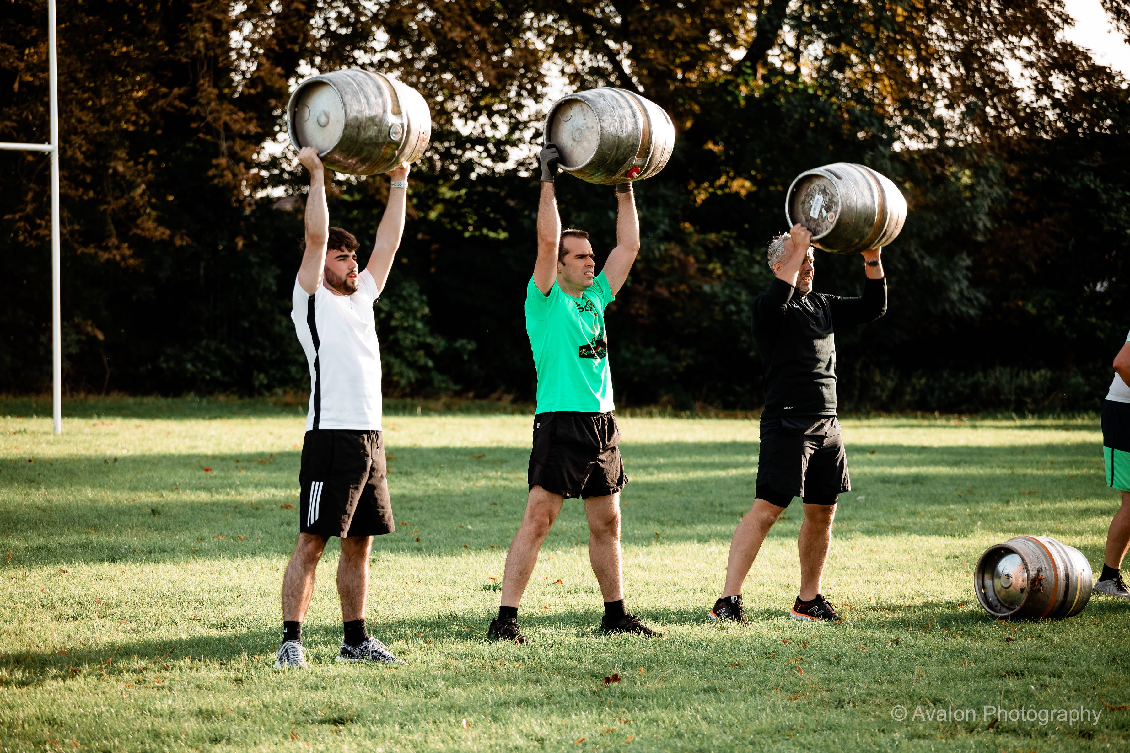 People training with barrel