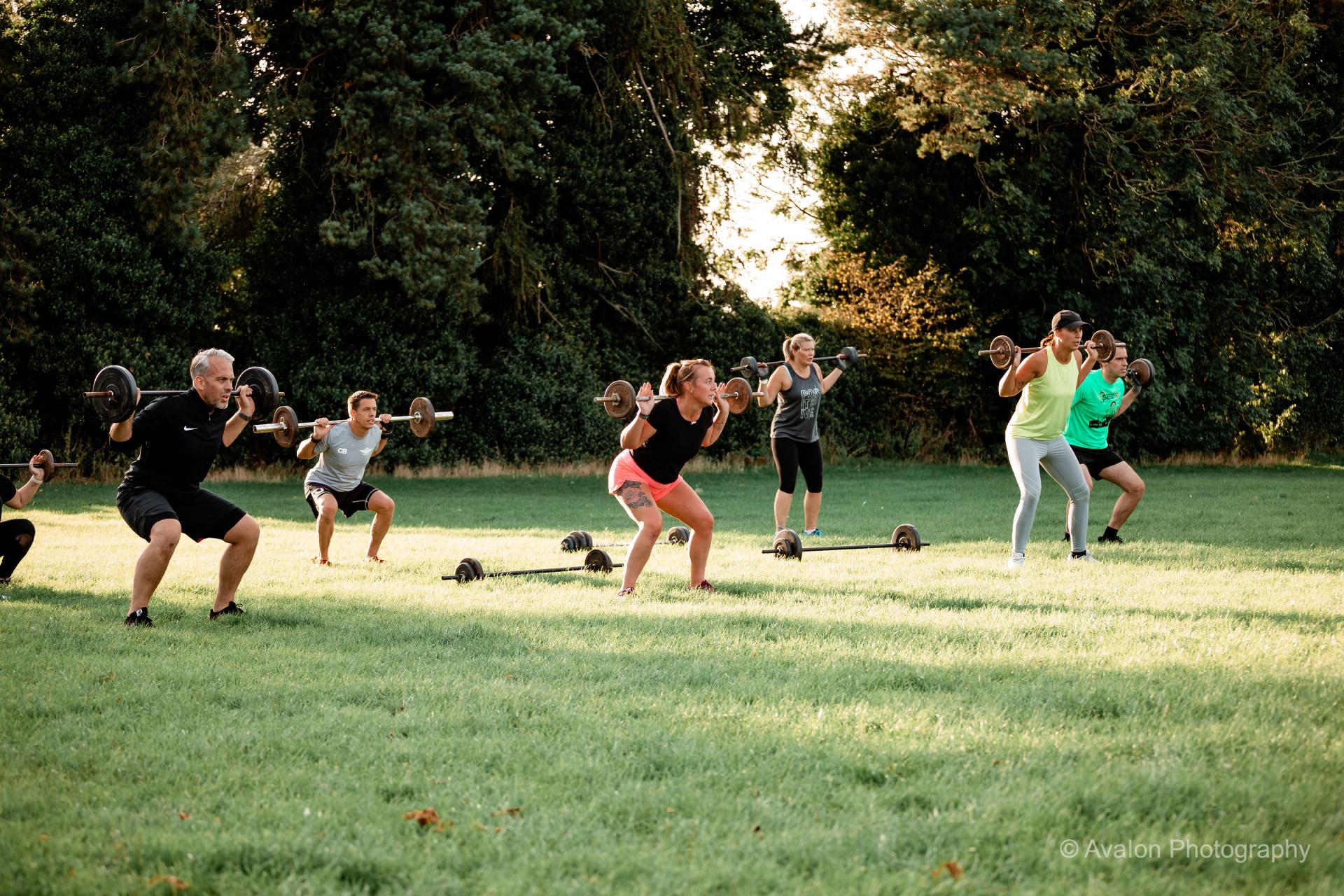 Group Lifting Weights at a camp